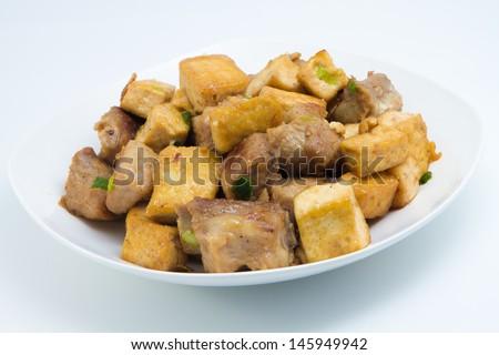 Fried tofu and pork ribs, a homemade food, made from pork rib and tofu, eat with rice as main dish