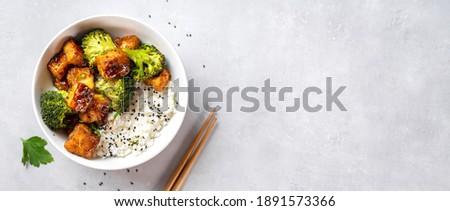 Fried tofu bowl with broccoli and rice. Vegan food Сток-фото ©