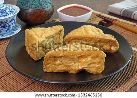 Fried Tofu, served with sweet and spicy chili sauce. Vegetarian food for Vegetarian festival. Selective focus