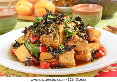 Fried tofu with red pepper and perilla