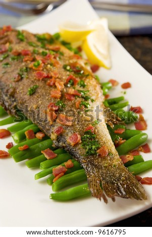 Fried trout with bacon and beans