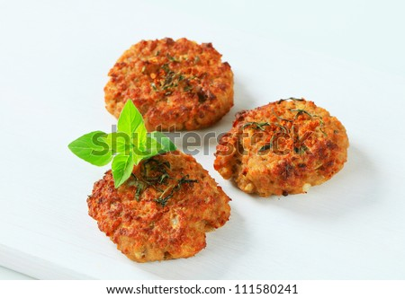 Fried vegetable burgers on white