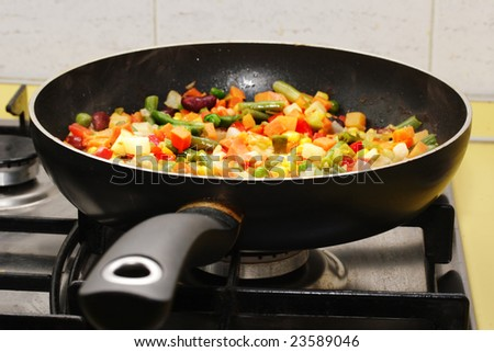 Fried vegetables on the skillet. Hot and fresh. Narrow depth of field.