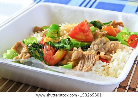 Fried Vegetables with pork on rice.