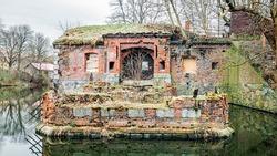 Friedland Ravelin in Kaliningrad, the moat around the old historic brick building