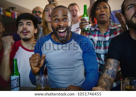 Frieds cheering sport at bar together #1051746455