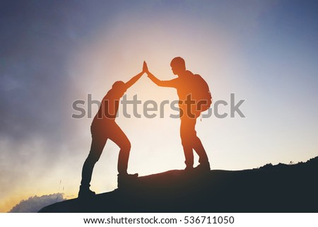 friend hiking help each other...