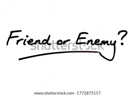 Friend or Enemy? handwritten on a white background. Stock photo ©