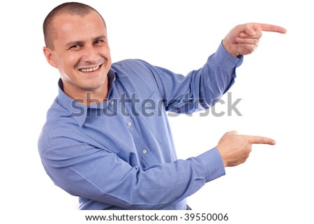 Friendly and happy young businessman pointing to the side of the image