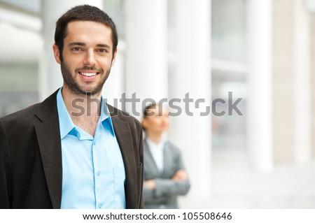 Friendly and smiling businessman looking at camera