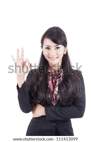 Friendly Asian Business woman giving the OK sign on white background