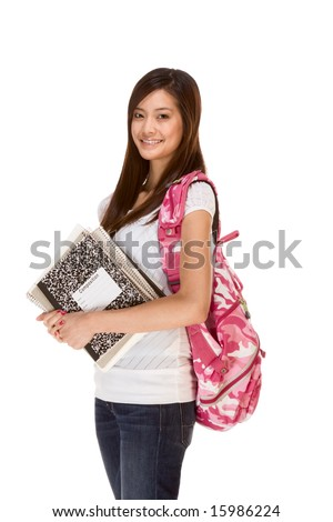 Friendly Asian High school girl student standing in jeans with backpack and holding notebooks and composition book