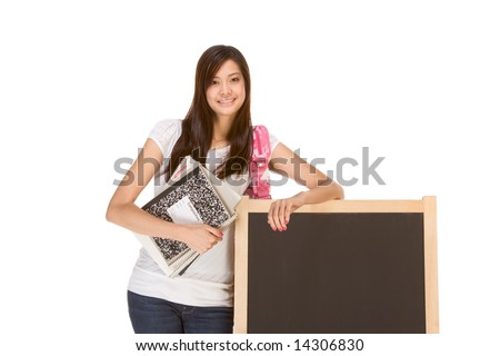 Friendly Asian High school girl student standing in jeans with backpack and holding spiral notebooks and composition book