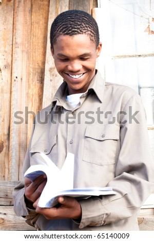 Friendly black student paging through his book.