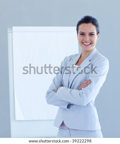 Friendly businesswoman giving a presentation in business