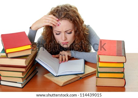 Friendly College student girl with books at the desk isolated