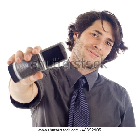 Friendly confident business man holding a mobile phone, isolated over a white background