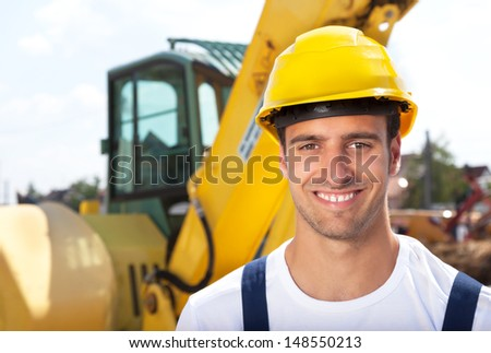 Friendly construction worker with his excavator