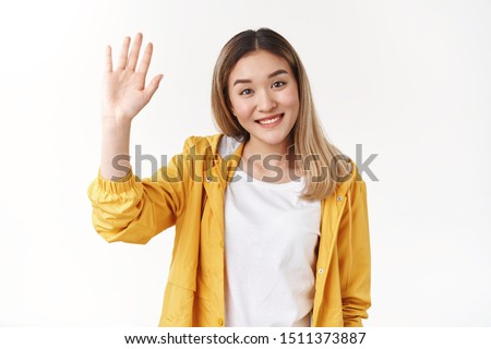 Friendly cute cheerful outgoing asian blond girl raise hand up high five wanna say hi hello greeting joyfully smiling broadly toothy positive grin welcoming team members introduce herself
