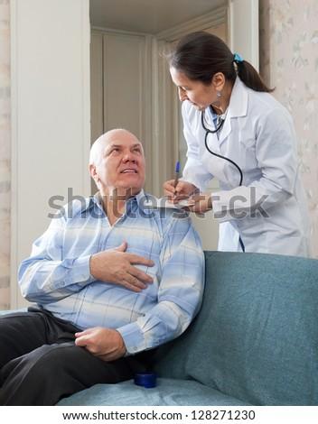 friendly doctor asks mature man feels at medical hospital
