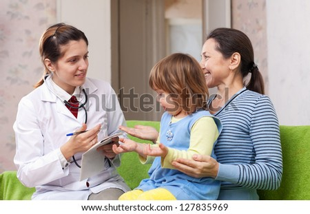 friendly doctor examining baby girl. Focus on adults