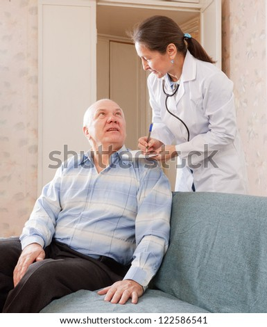 friendly doctor talks with  senior male patient
