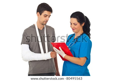 Friendly doctor woman giving prescription to injured man and writing ...