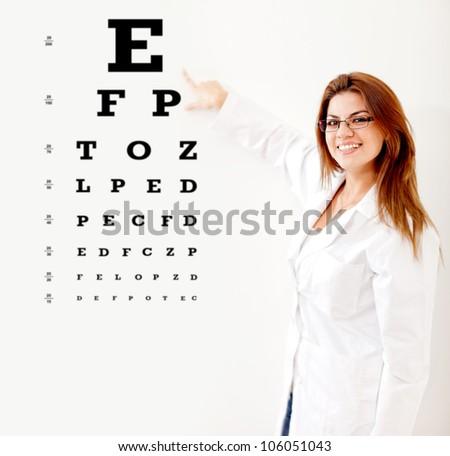 Friendly female optician making an eye exam