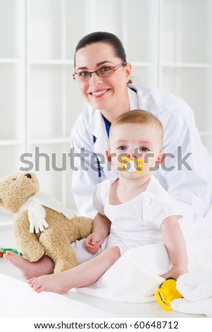 friendly female pediatrician and baby girl
