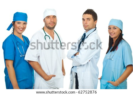 Friendly four different doctors standing in a row isolated on white background