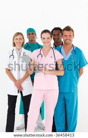 Friendly group of multi-ethnic doctors smiling at the camera
