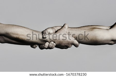 Friendly handshake, friends greeting, teamwork, friendship. Close-up. Rescue, helping gesture or hands. Strong hold. Two hands, helping hand of a friend. Handshake, arms, friendship. Black and white. Stock photo ©