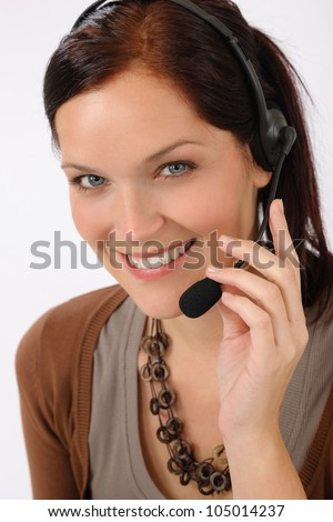 Friendly help desk woman smiling call center operator phone headset