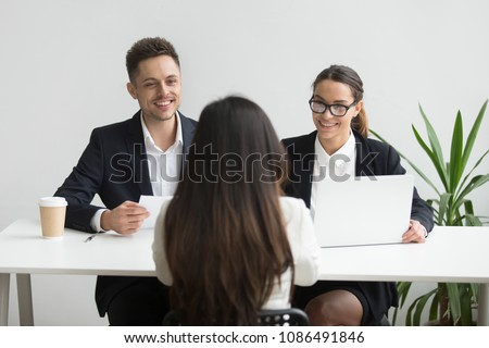 Friendly hr managers interviewing female job applicant, professional smiling recruiters talking to winning vacancy candidate making hiring decision, good performance or great first impression concept