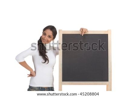 Friendly Indian college student woman by chalkboard