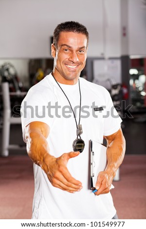 friendly male personal trainer hand shake