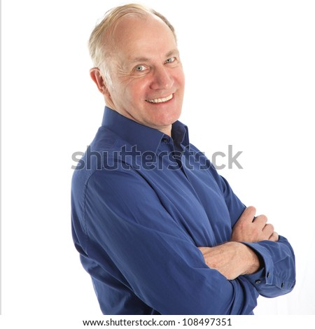 Friendly man with beaming smile Friendly middle-aged man with a beaming smile brimming over with health and vitality isolated on white