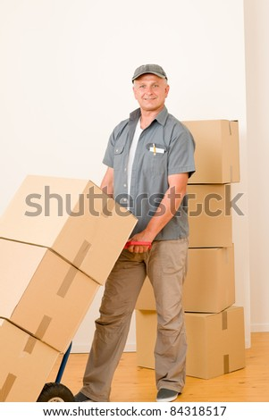 Friendly messenger or mover delivering parcel boxes on hand truck