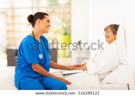friendly nurse visiting recovering senior patient