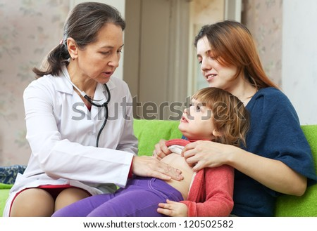 friendly  pediatrician doctor examining baby in home - stock photo
