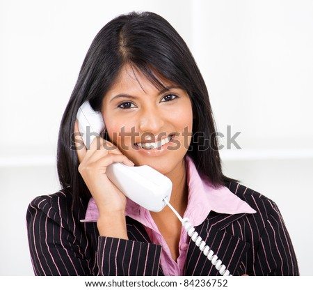 friendly receptionist on phone