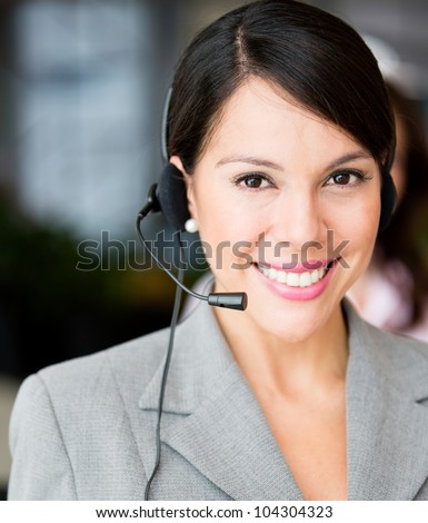 Friendly receptionist smiling and wearing a headset