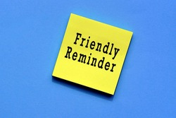 Friendly reminder text on yellow sticky note with blue background