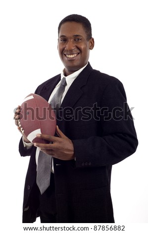 Friendly smiling black businessman holding a football isolated over white background