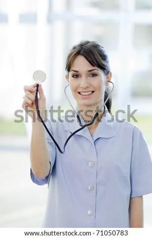 Friendly Smiling Female Nurse Holding Stethoscope