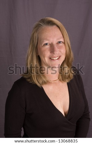 Friendly smiling middle-aged woman shot from above for dating service image, isolated on gray