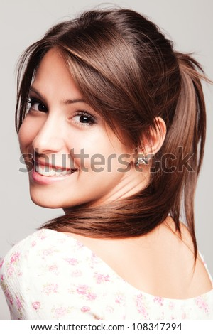 friendly smiling young woman portrait studio shot