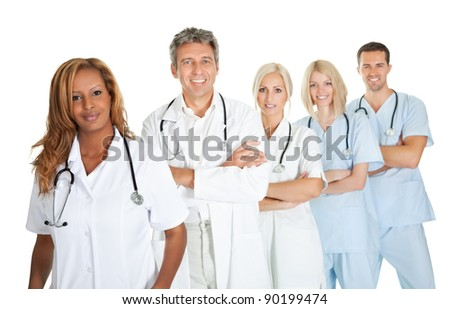 Friendly team of doctors smiling over white background