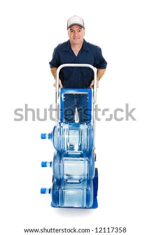 Friendly water delivery man with a hand truck loaded with 5 gallon water jugs.  Full body isolated on white.