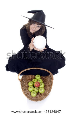 Friendly witch treading us on a basket of apples while looking in her crystal ball